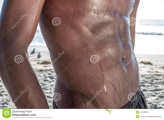 dark-lean-abs-closeup-beautiful-toned-waist-dripping-water-african-american-man-beach-44748636